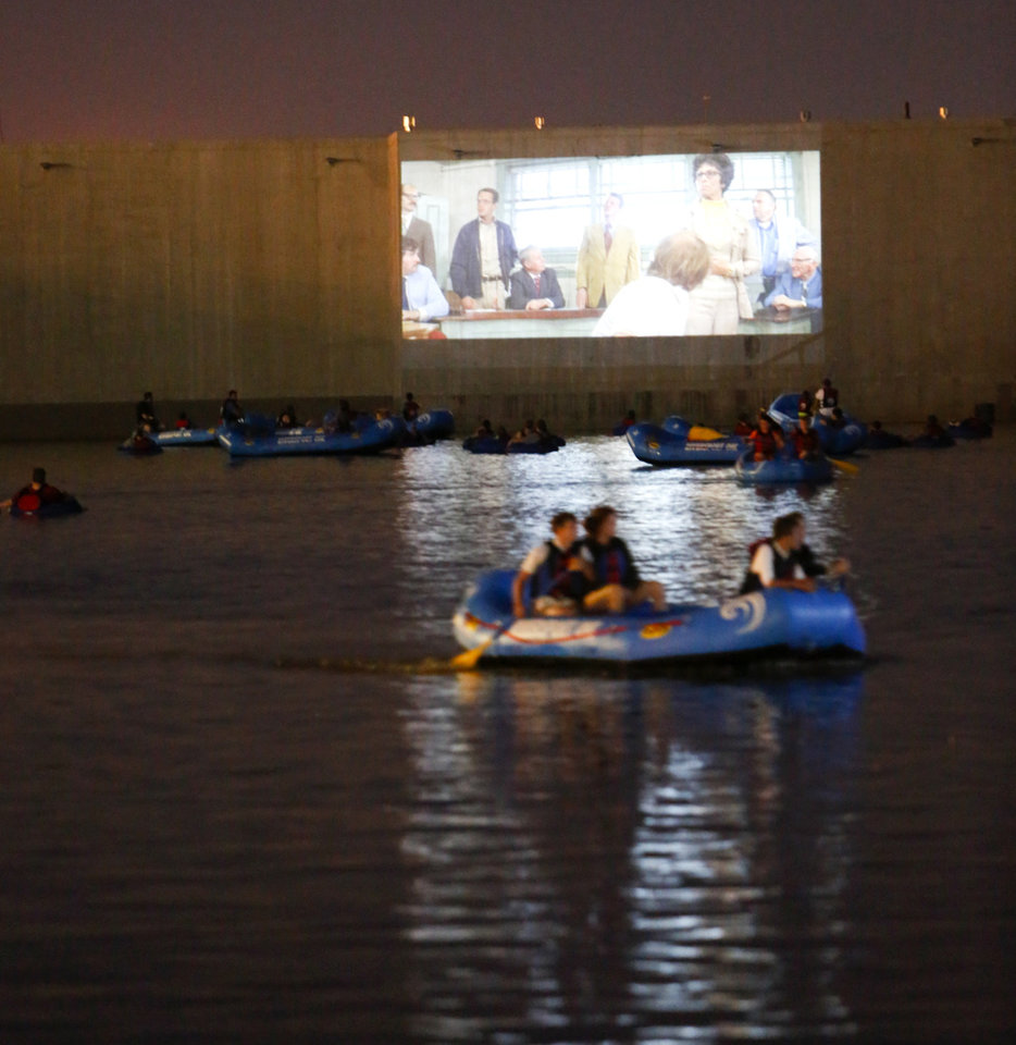 Photo -  Attendees of a 2016 RiverSport Rapids' Floating Films series watch the movie