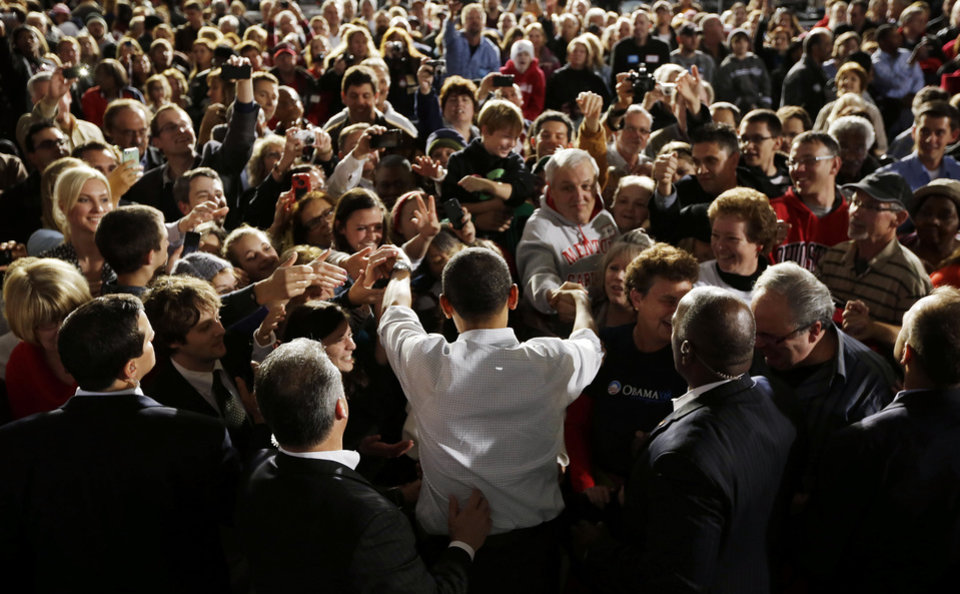President Barack Obama greets supporters after speaking to supporters during a campaign event at Mentor Hight School, Saturday, Nov. 3, 2012, in Mentor, Ohio. (AP Photo/Pablo Martinez Monsivais)
