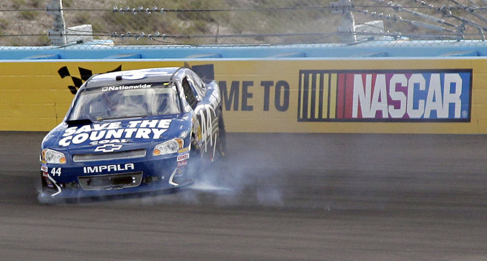 John Blankenshhip (44) gets sideway during the NASCAR Nationwide Series auto race, Saturday, Nov. 10, 2012, at Phoenix International Raceway in Avondale, Ariz. (AP Photo/Matt York)