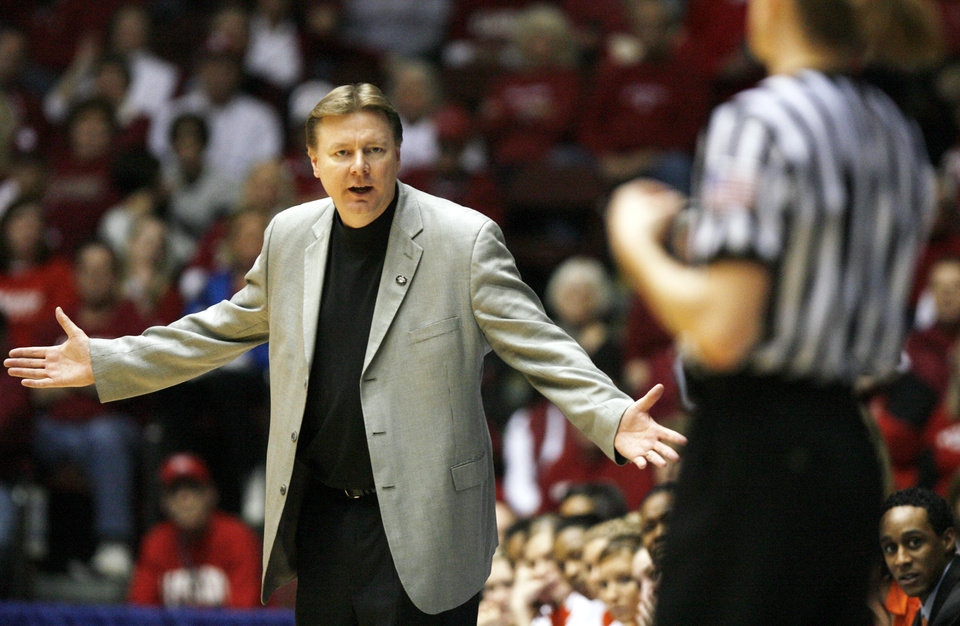 Photo - OSU head coach Kurt Budke questions a call by the officials in the second half of the women's college basketball Big 12 Championship tournament semifinal game between the University of Oklahoma and Oklahoma State University on Saturday, March 13, 2010, in Kansas City, Mo.   Photo by Chris Landsberger, The Oklahoman