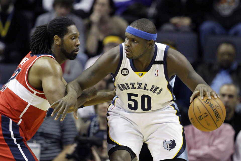 Memphis Grizzlies' Zach Randolph (50) works the ball around Washington Wizards' Nene, of Brazil, left, during the first half of an NBA basketball game in Memphis, Tenn., Friday, Feb. 1, 2013. (AP Photo/Danny Johnston)