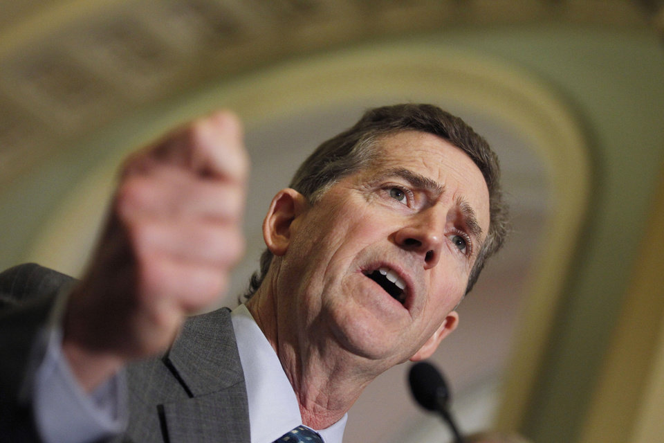 FILE - In this June 14, 2011, file photo Sen. Jim DeMint, R-S.C., speaks to media on Capitol Hill in Washington.  DeMint announced Thursday, Dec. 6, 2012  that he is resigning to take over at Heritage Foundation. (AP Photo/Alex Brandon, File)