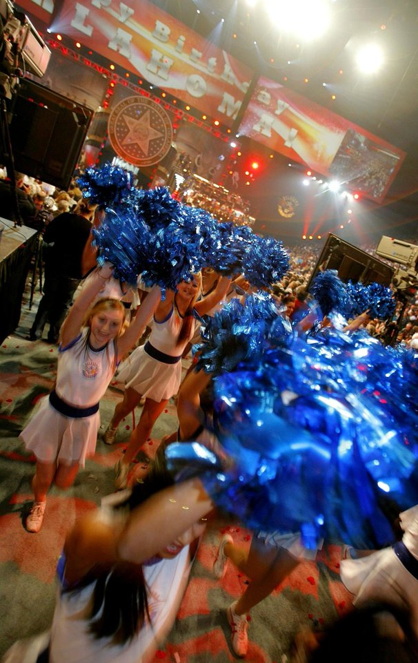 Photo - CONCERT: The Centennial cheerleaders perform during the Centennial Spectacular to celebrate the 100th birthday of the State of Oklahoma at the Ford Center on Friday, Nov. 16, 2007, in Oklahoma City, Okla.   STAFF PHOTO BY CHRIS LANDSBERGER/THE OKLAHOMAN  ORG XMIT: KOD