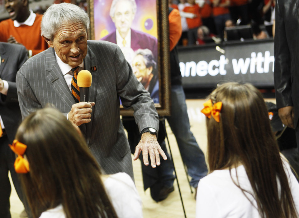 "Photo - Legendary Oklahoma State coach Eddie Sutton speaks with his grand daughters as he was honored at half time of an NCAA college basketball game between Oklahoma State University (OSU) and Iowa State at Gallagher-Iba Arena in Stillwater, Okla., Monday, Feb. 3, 2014. The event was proclaimed ""Eddie Sutton Night"" in honor of Sutton's years of coaching the Cowboys. Photo by KT King, The Oklahoman"