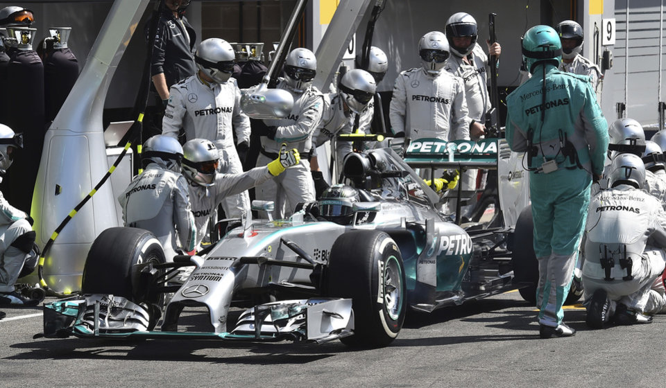Photo - Mercedes driver Nico Rosberg of Germany gets a pit service during the Belgium Formula One race at the Spa-Francorchamps circuit, Belgium, Sunday, Aug. 24, 2014.Red Bull driver Daniel Ricciardo won an incident-packed Belgian Grand Prix on Sunday, while Nico Rosberg was second to extend his championship lead over Mercedes teammate Lewis Hamilton in acrimonious circumstances. (AP Photo/ Ben Stansall , Pool)