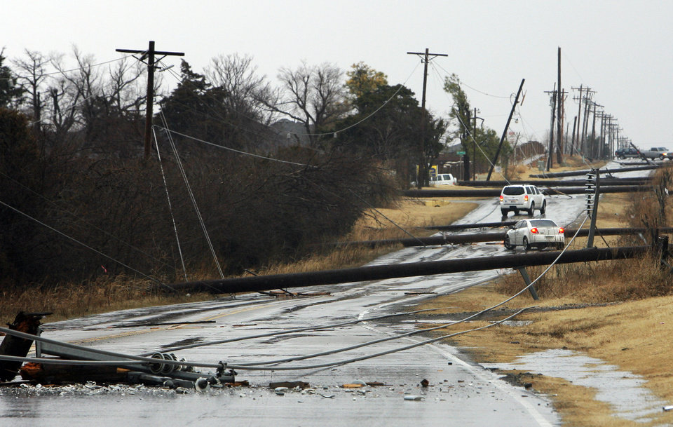 Photo - High line poles blown over on north Penn just south of 150 in Oklahoma City, Tuesday , February 10, 2009.  By David McDaniel, The Oklahoman.