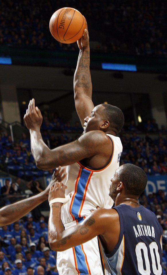 Photo - Oklahoma City's Kendrick Perkins (5) takes a shot in front of Darrell Arthur (00) of Memphis in the first half during game one of the Western Conference semifinals between the Memphis Grizzlies and the Oklahoma City Thunder in the NBA basketball playoffs at Oklahoma City Arena in Oklahoma City, Sunday, May 1, 2011. Photo by Nate Billings, The Oklahoman