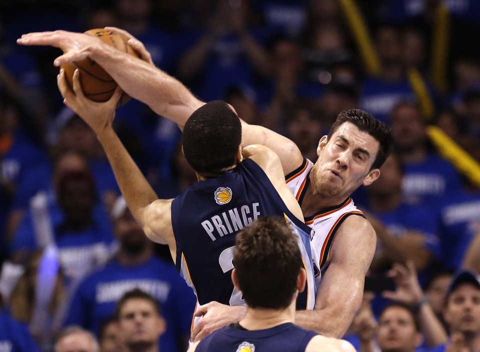 Oklahoma City's Nick Collison (4) flagrant fouls Memphis' Tayshaun Prince (21) during Game 1 in the second round of the NBA playoffs between the Oklahoma City Thunder and the Memphis Grizzlies at Chesapeake Energy Arena in Oklahoma City, Sunday, May 5, 2013. Photo by Sarah Phipps, The Oklahoman