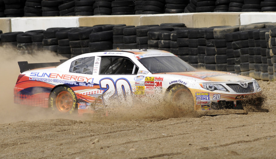 Photo - Kenny Habul drives through the gravel trap after going off course in turn four during the NASCAR Nationwide Series Nationwide Children's Hospital 200 auto race at Mid-Ohio Sports Car Course, Saturday, Aug. 16, 2014, in Lexington, Ohio. (AP Photo/Tom E. Puskar)