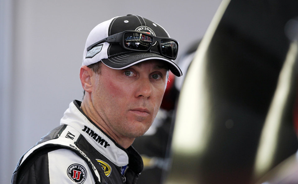 Photo - Kevin Harvick works in the garage during NASCAR Sprint Cup auto racing practice on Friday, March 7, 2014, in Las Vegas. (AP Photo/Isaac Brekken)