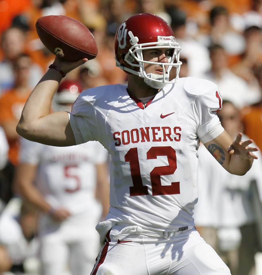 Photo - OU's Landry Jones passes the ball during the Red River Rivalry college football game between the University of Oklahoma Sooners (OU) and the University of Texas Longhorns (UT) at the Cotton Bowl in Dallas, Texas, Saturday, Oct. 17, 2009. Photo by Bryan Terry, The Oklahoman