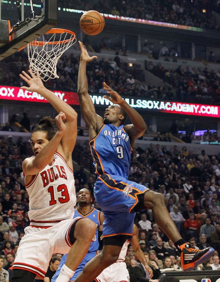 Oklahoma City Thunder forward Serge Ibaka (9) shoots over Chicago Bulls center Joakim Noah (13) during the first half of an NBA basketball game, Thursday, Nov. 8, 2012, in Chicago. (AP Photo/Charlie Arbogast) ORG XMIT: CXA101