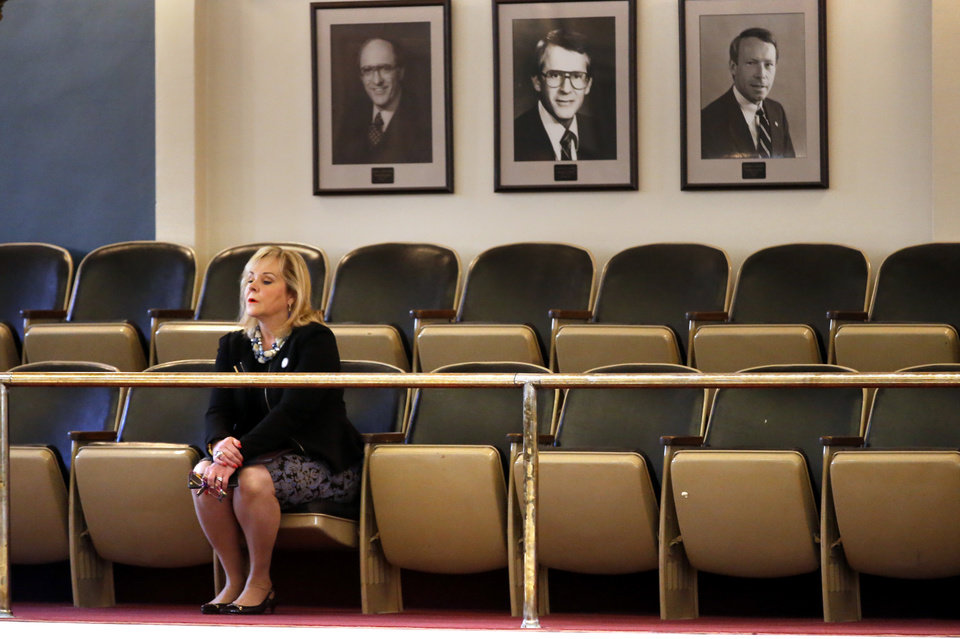 Photo -  Oklahoma Gov. Mary Fallin watches from the visitor gallery as the Senate debates a bill to cut $60 million from the state budget and fill most of the $215 million shortfall with one-time appropriations. Both the House and Senate adjourned special session on Friday. [Photo by Steve Sisney, The Oklahoman]