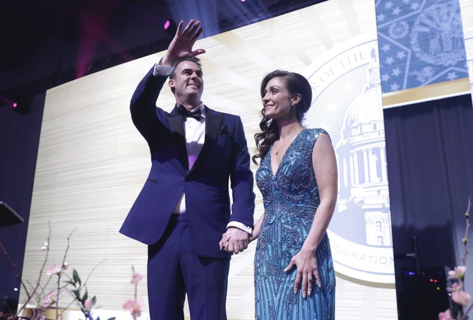 Photo -  Gov. Kevin Stitt and his wife, Sarah, arrive at the Pre-inaugural Redbud Ball at the Cox Business Center Saturday, Jan. 12, 2019, in Tulsa. [Mike Simons/Tulsa World]