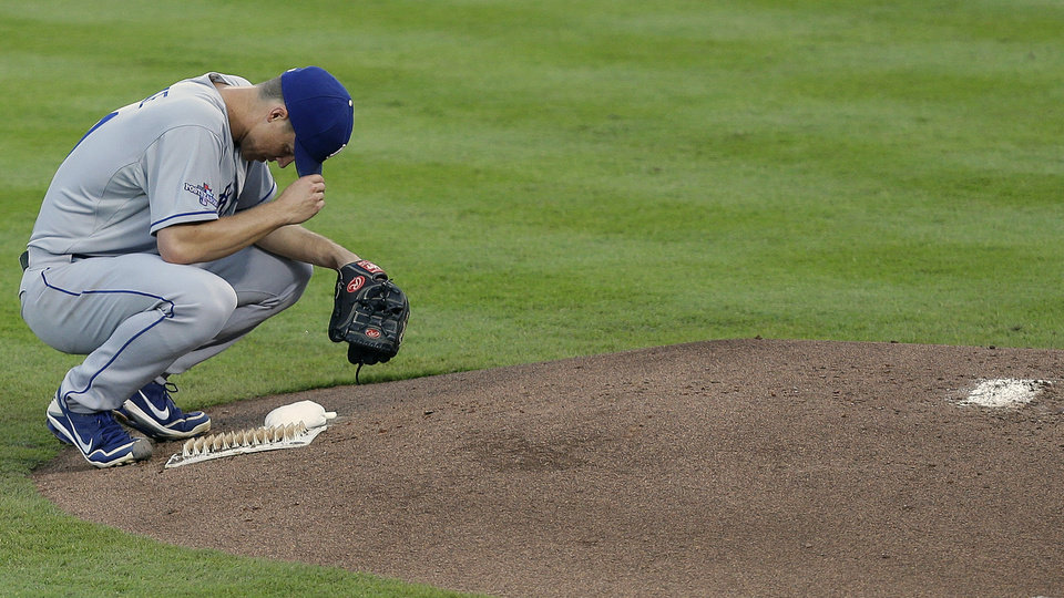 Photo - Los Angeles Dodgers starting pitcher Zack Greinke rests after Atlanta Braves'Andrelton Simmons doubled in the second inning of Game 2 of the National League division series on Friday, Oct. 4, 2013, in Atlanta. (AP Photo/Mike Zarrilli)