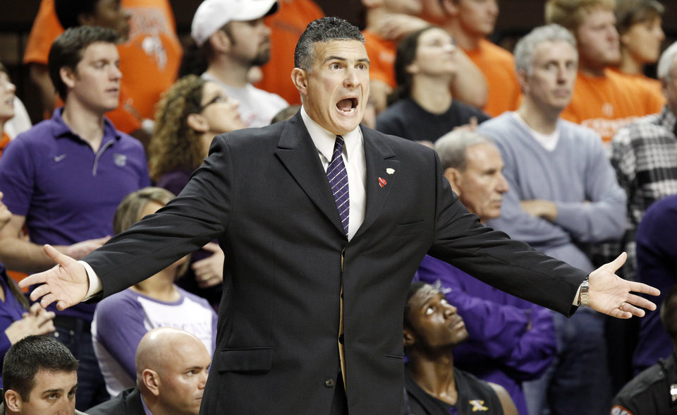 Photo - KSU head coach Frank Martin yells at an official during the men's college basketball game between Oklahoma State University (OSU) and Kansas State University (KSU) at Gallagher-Iba Arena in Stillwater, Okla., Saturday, January 8, 2011. Photo by Nate Billings, The Oklahoman