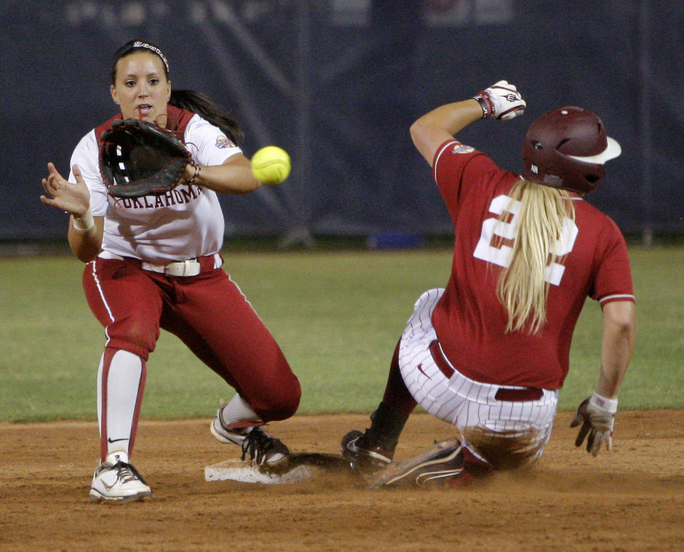 Photo - Alabama's Amanda Locke (22) slides to second as Oklahoma's Javen Henson (7) waits for the ball in the seventh inning during the championship game of the Women's College World Series as ASA Stadium in Oklahoma City, Tuesday, June 5, 2012. Photo by Bryan Terry, The Oklahoman