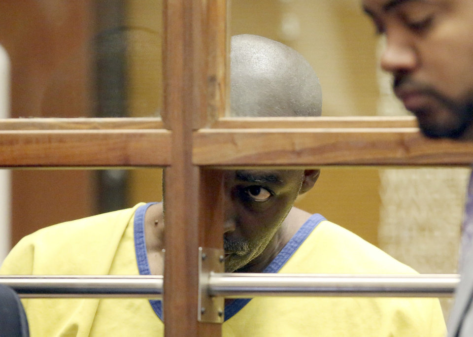 Photo - Actor Michael Jace appears in court in Los Angeles Wednesday, June 18, 2014. Jace, a 51-year-old actor who played a police officer in the hit TV series