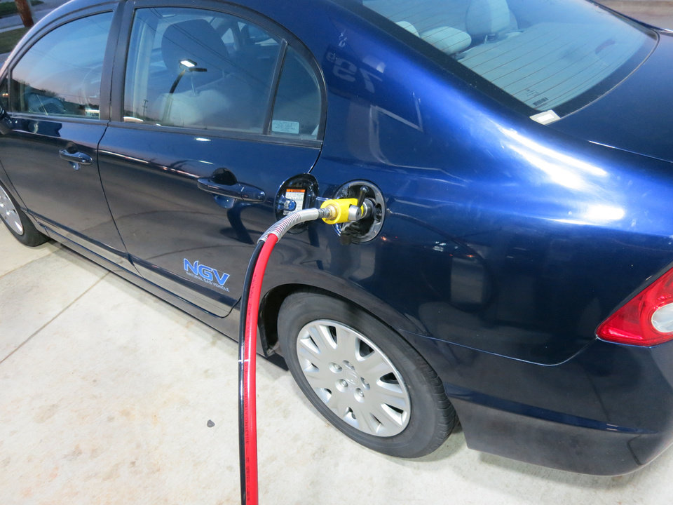 Photo - Adam Wilmoth fills up his recently purchased CNG-powered Honda Civic. PHOTO BY ADAM WILMOTH, THE OKLAHOMAN