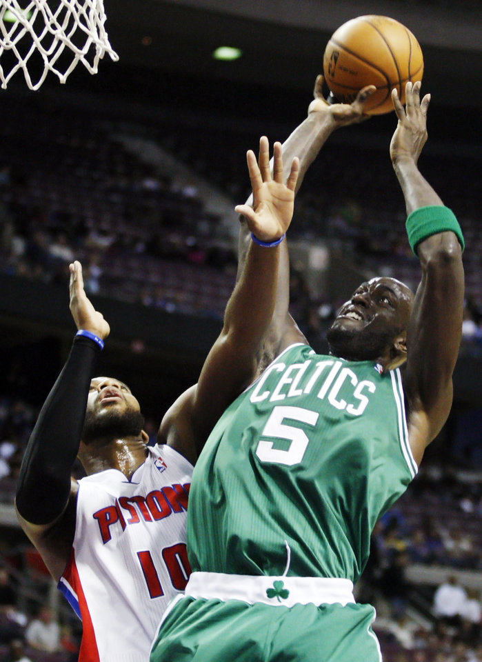 Boston Celtics center Kevin Garnett (5) shoots against Detroit Pistons center Greg Monroe in the first half of an NBA basketball game, Sunday, Nov. 18, 2012, in Auburn Hills, Mich. (AP Photo/Duane Burleson)