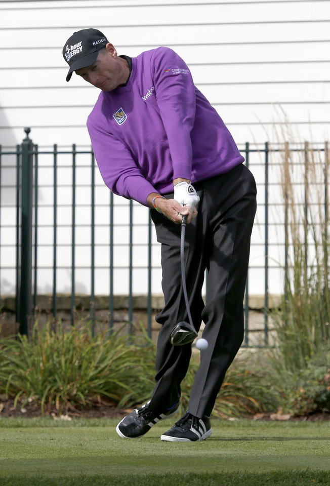 Photo - Jim Furyk strikes his tee shot at the third hole during the final round of the BMW Championship golf tournament at Conway Farms Golf Club in Lake Forest, Ill., Monday, Sept. 16, 2013. (AP Photo/Charles Rex Arbogast)