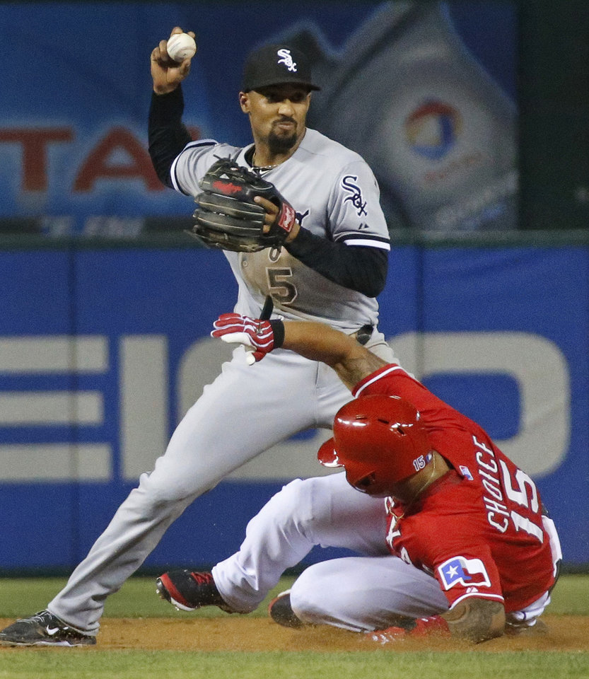 Photo - Texas Rangers' Michael Choice, right, slides hard into Chicago White Sox second baseman Marcus Semien to break up a double play in the eighth inning of a baseball game in Arlington, Texas, Saturday, April 19, 2014. (AP Photo/Dallas Morning News, Louis DeLuca) MANDATORY CREDIT; NO SALES; MAGAZINES OUT; TV OUT; INTERNET USE BY AP MEMBERS ONLY