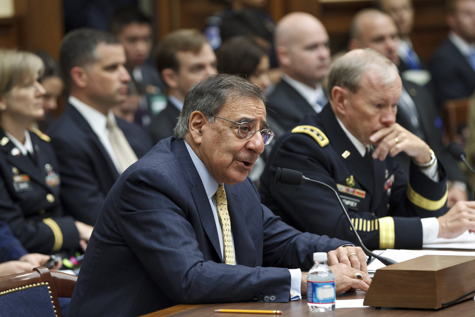 Photo -   Defense Secretary Leon Panetta, left, accompanied by Joint Chiefs Chairman Gen. Martin Dempsey, testifies on Capitol Hill in Washington, Thursday, April, 19, 2012, before the House Armed Services Committee hearing on recent developments with the crisis in Syria. (AP Photo/J. Scott Applewhite)