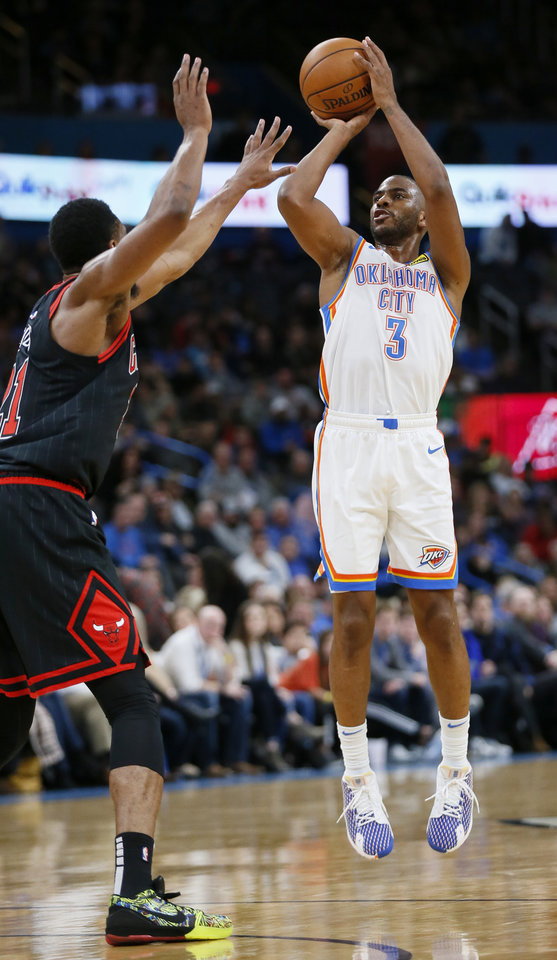 Photo - Oklahoma City's Chris Paul (3) shoots as Chicago's Thaddeus Young (21) defends in the second quarter during an NBA basketball game between the Oklahoma City Thunder and Chicago Bulls at Chesapeake Energy Arena in Oklahoma City, Monday, Dec. 16, 2019. [Nate Billings/The Oklahoman]