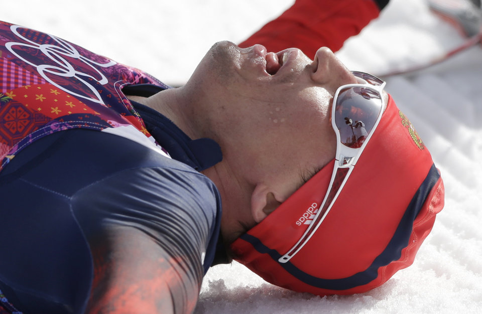 Photo - Russia's Alexander Legkov catches his breath after winning the gold during the men's 50K cross-country race at the 2014 Winter Olympics, Sunday, Feb. 23, 2014, in Krasnaya Polyana, Russia. (AP Photo/Matthias Schrader)