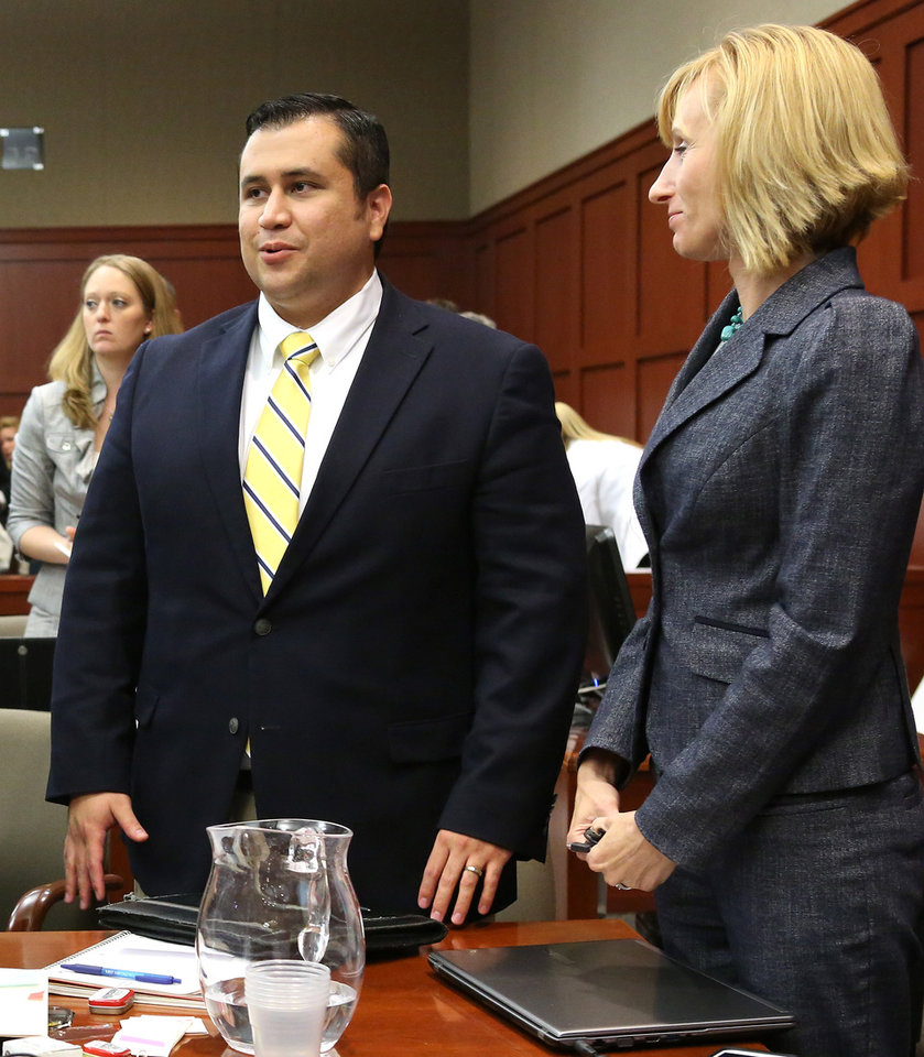 Photo - George Zimmerman, left, smiles while standing next to defense counsel Lorna Truettwhile, waiting for the jury to leave the courtroom during the 15th day of his trial in Seminole circuit court, in Sanford, Fla., Friday, June 28, 2013.  Zimmerman is charged with second-degree murder for the 2012 shooting death of Trayvon Martin. (AP Photo/Orlando Sentinel, Joe Burbank, Pool)