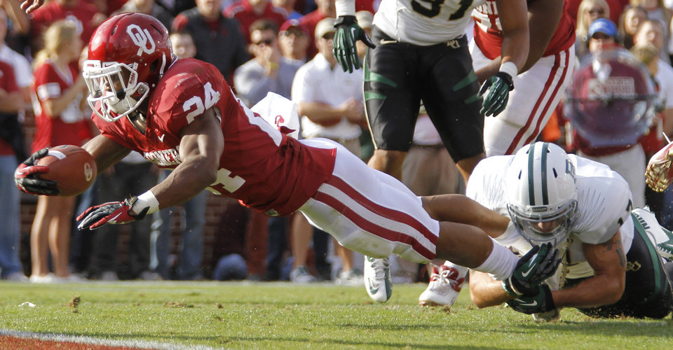 Oklahoma\'s Brennan Clay (24) dives for the end zone past Baylor\'s Mike Hicks (17) during the college football game between the University of Oklahoma Sooners (OU) and Baylor University Bears (BU) at Gaylord Family - Oklahoma Memorial Stadium on Saturday, Nov. 10, 2012, in Norman, Okla. Photo by Chris Landsberger, The Oklahoman