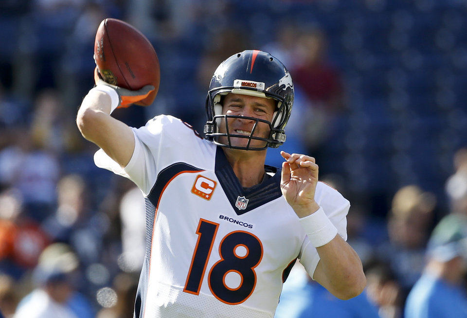 Photo - Denver Broncos quarterback Peyton Manning warms up before an NFL football game against the San Diego Chargers, Sunday, Dec. 14, 2014, in San Diego. (AP Photo/Lenny Ignelzi)