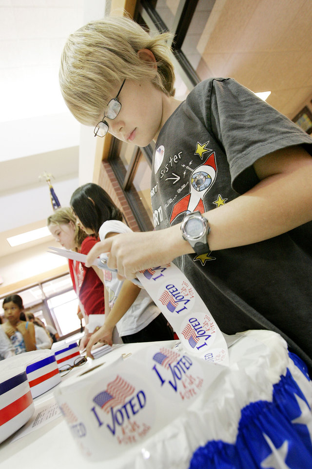 Photo - Trumann elem. student Sawyer Robertson 10 a 5th grader cut stickers as student take part in a mock election Tuesday, Nov. 4th 2008. BY JACONNA AGUIRRE, THE OKLAHOMAN.