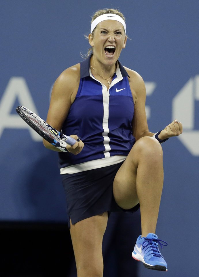 Photo - Victoria Azarenka,  of Belarus, reacts after defeating Aleksandra Krunic, of Serbia, during the fourth round of the 2014 U.S. Open tennis tournament Monday, Sept. 1, 2014, in New York. (AP Photo/Darron Cummings)