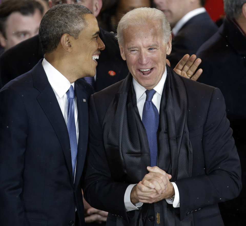 President Barack Obama talks with Vice President Joe Biden in the presidential box during the inaugural parade down Pennsylvania Avenue en route to the White House, Monday, Jan. 21, 2013, in Washington. Thousands  marched during the 57th Presidential Inauguration parade after the ceremonial swearing-in of President Barack Obama. (AP Photo/Gerald Herbert) ORG XMIT: DCMS170