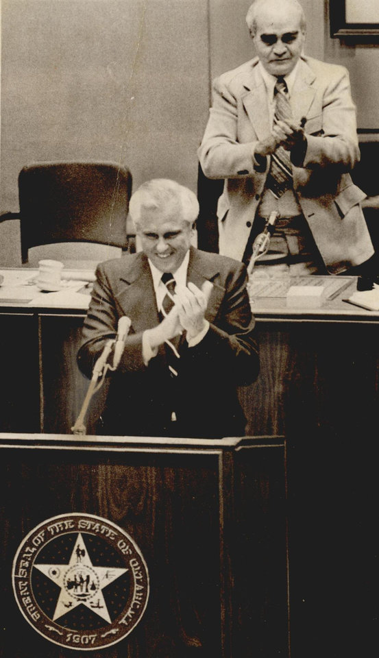Photo - Gov. David Hall and House Speaker Bill Willis applaud the adjournment of the 34th Legislature in the House chambers in 1974. [Photo by Gary Guidice, The Oklahoman Archives]