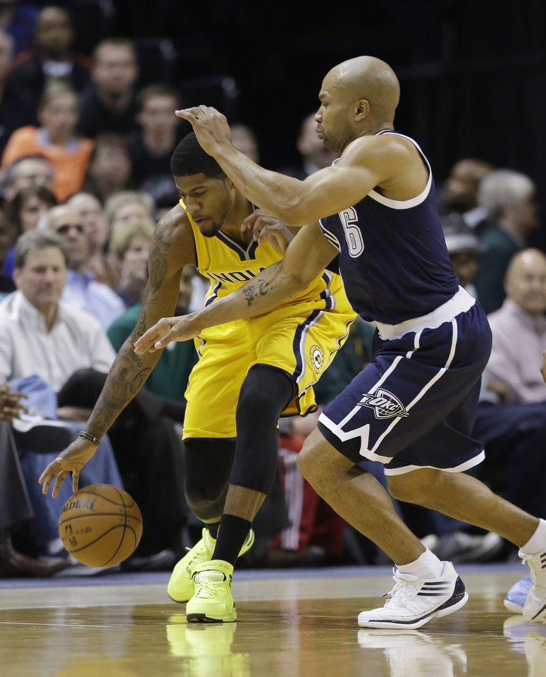 Photo - Indiana Pacers' Paul George, left, and Oklahoma City Thunder's Derek Fisher (6) go for a loose ball during the first half of an NBA basketball game on Friday, April 5, 2013, in Indianapolis. (AP Photo/Darron Cummings)