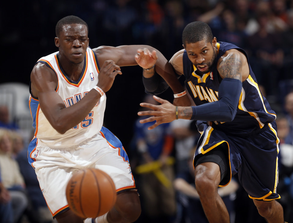 Oklahoma City's Reggie Jackson (15) and Indiana's C.J. Watson go for a loose ball during the NBA game between the Oklahoma City Thunder and the Indiana Pacers at the Chesapeake Energy Arena, Sunday, Dec. 8, 2013. Photo by Sarah Phipps, The Oklahoman