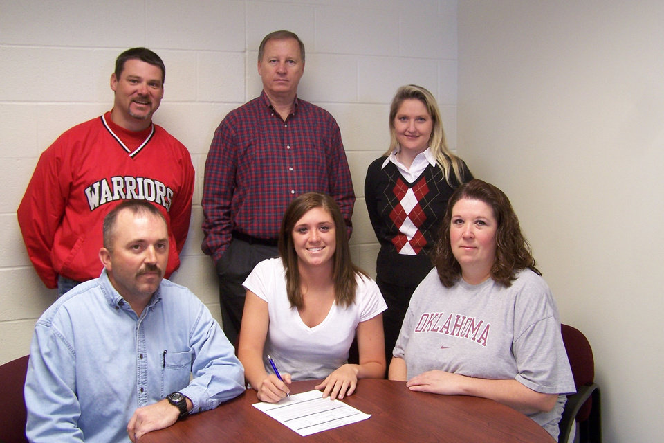 Washington High School senior, Kelsey Houck, signed to play basketball with Redland Community College in El Reno.  Pictured (seated l-r), father, Joey Houck, Kelsey, mother, Kelly Houck.  Standing (l-r) WHS Coach Darrin Dean, WHS Head Coach Rocky Clarke, and Redlands Head Coach  Laci Tompkins.<br/><b>Community Photo By:</b> LuGlena Moore<br/><b>Submitted By:</b> kelsey , washington