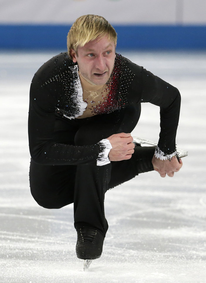 Photo - Evgeny Plyushchenko of Russia competes in the men's team short program figure skating competition at the Iceberg Skating Palace during the 2014 Winter Olympics, Thursday, Feb. 6, 2014, in Sochi, Russia. (AP Photo/Bernat Armangue)