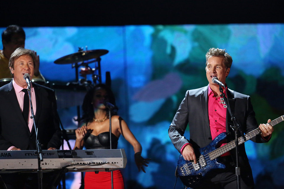 Photo - Peter Cetera, left, and Robert Lamm of Chicago perform a medley on stage at the 56th annual Grammy Awards at Staples Center on Sunday, Jan. 26, 2014, in Los Angeles. (Photo by Matt Sayles/Invision/AP)