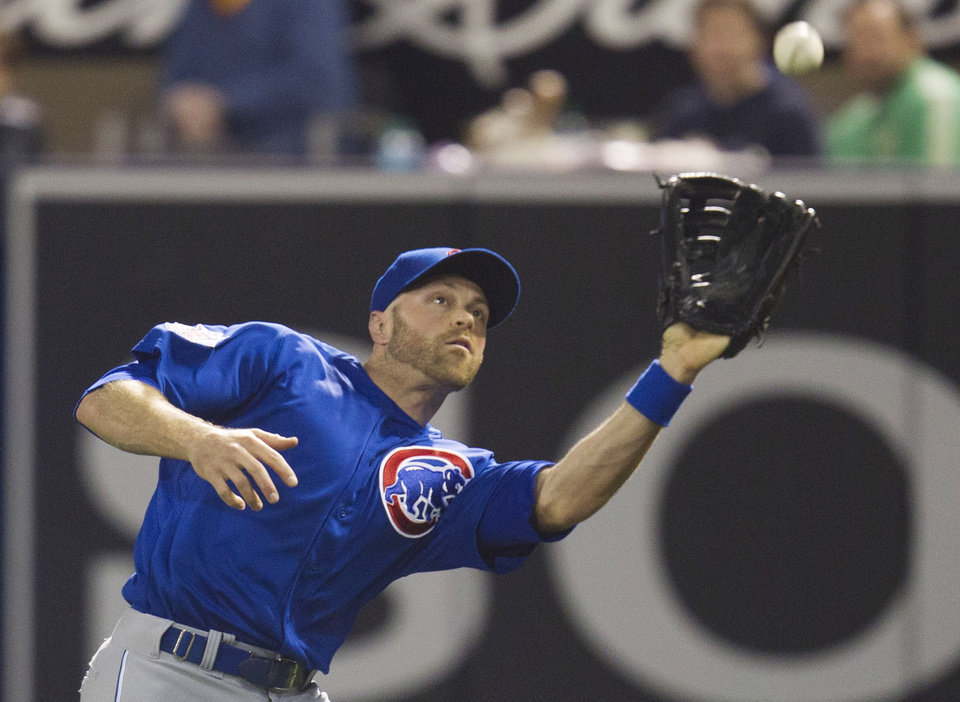 Photo - Chicago Cubs right fielder Nate Schierholtz catches a fly ball hit by San Diego Padres' Jedd Gyorko in the seventh inning of a baseball game Saturday, May 24, 2014, in San Diego. (AP Photo/Sean M. Haffey)