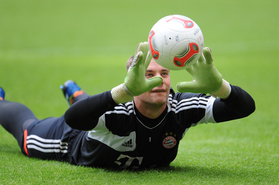 Photo - Munich's goalie Manuel Neuer  exercises during a practice session of the Bayern soccer squad in Munich, Germany Tuesday May 14, 2013. Bayern Munich will face German club of  Borussia Dortmund in a Champions League final match in London on May 25, 2013.  (AP Photo/dpa,Andreas Gebert)