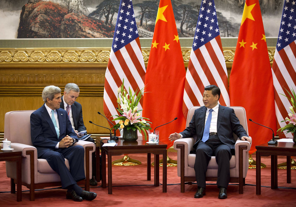Photo - U.S. Secretary of State John Kerry, left, meets with Chinese President Xi Jinping, right, after attending the 6th U.S.-China Strategic and Economic Dialogue and 5th round of U.S. -China High Level consultation on People-to-people Exchange at the Great Hall of the People in Beijing, China Thursday, July 10, 2014. (AP Photo/Andy Wong, Pool)