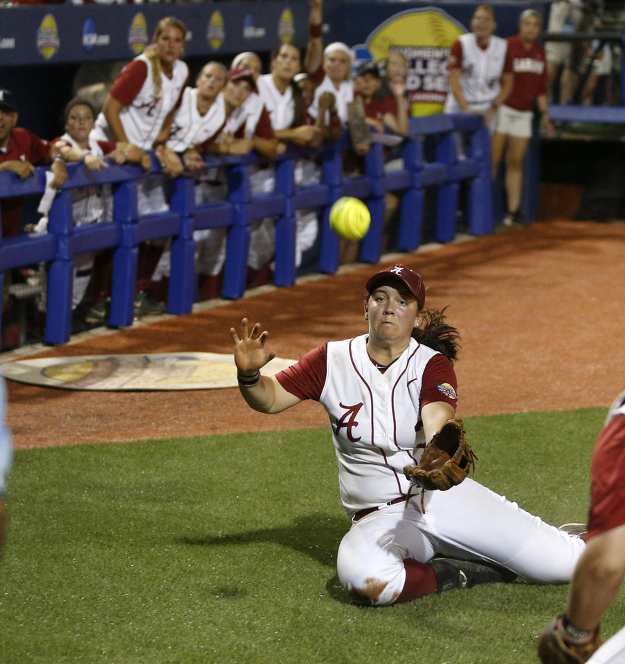 Photo - Alabama's Peyton Grantham (3) dives for a foul ball in the seventh inning of a Women's College World Series game between the University of Oklahoma and Alabama at ASA Hall of Fame Stadium in Oklahoma City Thursday, May 29, 2014. Photo by Bryan Terry, The Oklahoman