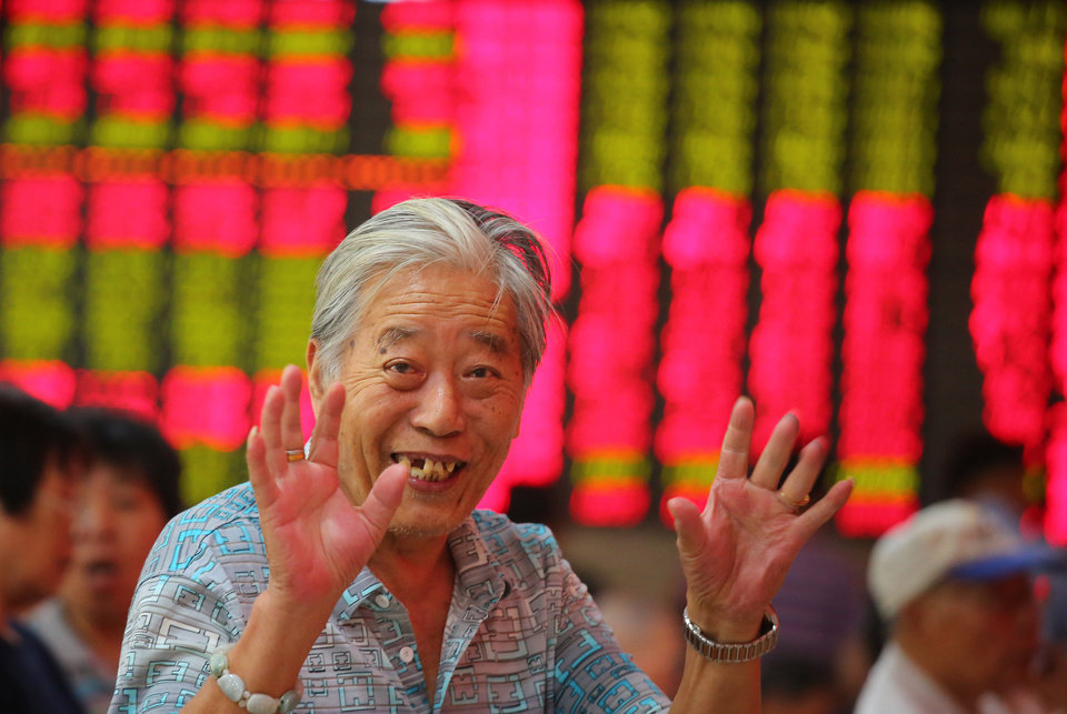 Photo - An investor gestures at a private securities company in Shanghai, China, Thursday, July 18, 2013. Asian stocks were mostly higher Thursday, tracking overnight gains in Europe and Wall Street after U.S. Federal Reserve chairman Ben Bernanke's suggested stimulus policies may continue for longer than expected. (AP Photo)