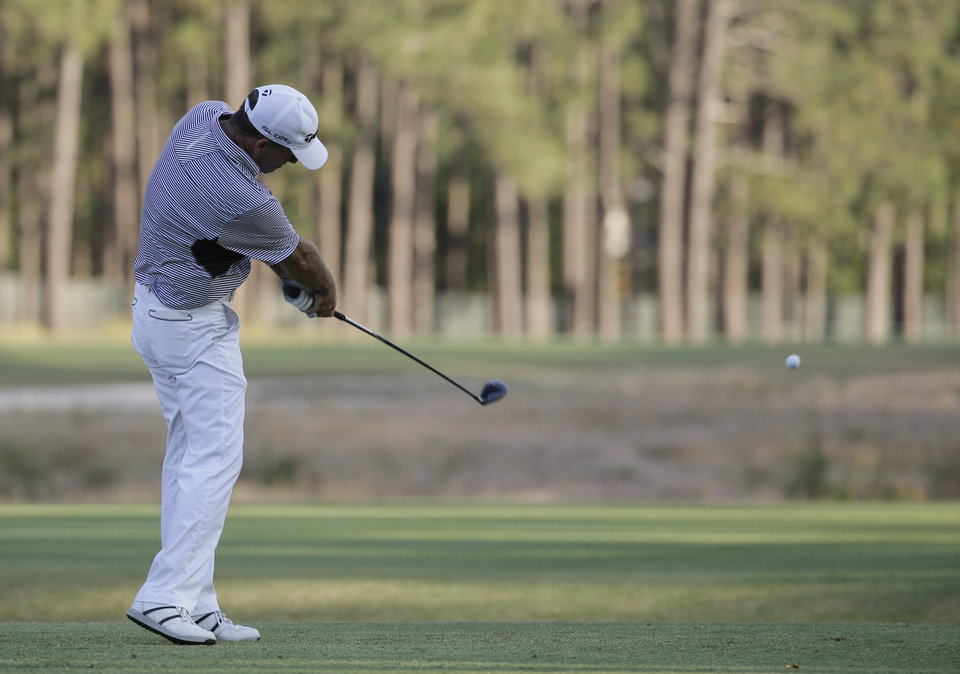 Photo - Fran Quinn hits his tee shot on the seventh hole during the first round of the U.S. Open golf tournament in Pinehurst, N.C., Thursday, June 12, 2014. (AP Photo/Eric Gay)