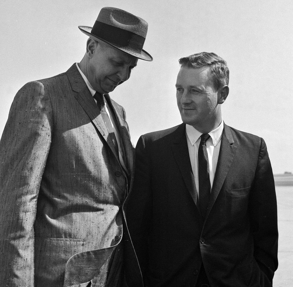 Photo - FILE - In this May 21, 1961 file photo, John Seigenthaler, right, the Kennedy administration's chief negotiator with the governor of Alabama during the 1961 Freedom Rides, talks with Charles Meriwether as they leave Montgomery, Ala. A day earlier, he was attacked and knocked unconscious by a mob of Klansmen in Montgomery, Ala., as tried to aid a young protester who was being pursued by the rioters. Meriwether, a former Alabama official who became a director of the Export-Import Bank of the United States, was visiting. Seigenthaler, the journalist who edited The Tennessean newspaper, helped shape USA Today and worked for civil rights during the Kennedy administration, died Friday, July 11, 2014. He was 86. (AP Photo)