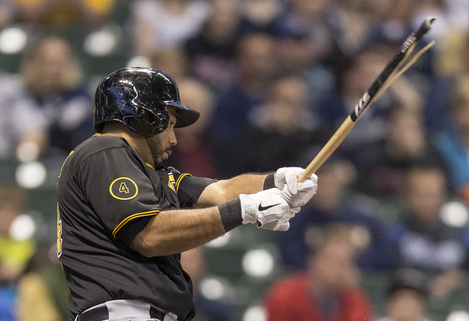 Photo - Pittsburgh Pirates' Pedro Alvarez grounds out with a broken bat against the Milwaukee Brewers during the first inning of a baseball game on Friday, April 11, 2014, in Milwaukee. (AP Photo/Tom Lynn)