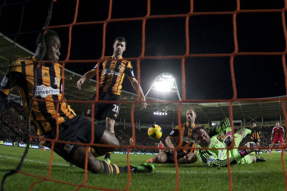 Photo - Hull City's goalkeeper Steve Harper, bottom right, dives in vain as Southampton's Jose Fonte, out of frame, scores during their English Premier League soccer match at the KC Stadium, Hull, England, Tuesday Feb. 11, 2014. (AP Photo/Jon Super)